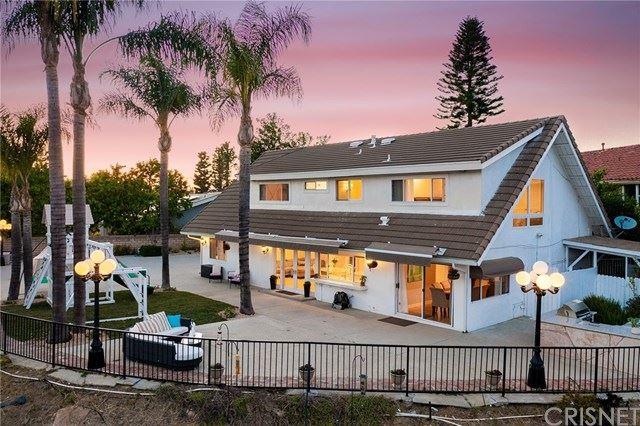 Photo of 19130 Menard Place, Tarzana, CA 91356 (MLS # SR21071183)