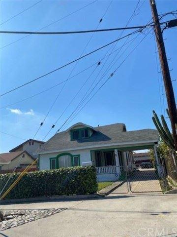 Photo of 667 S Humphreys Avenue, East Los Angeles, CA 90022 (MLS # PW21018187)