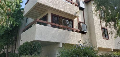 Photo of 27915 Sarabande Lane #413, Canyon Country, CA 91387 (MLS # CV21163193)