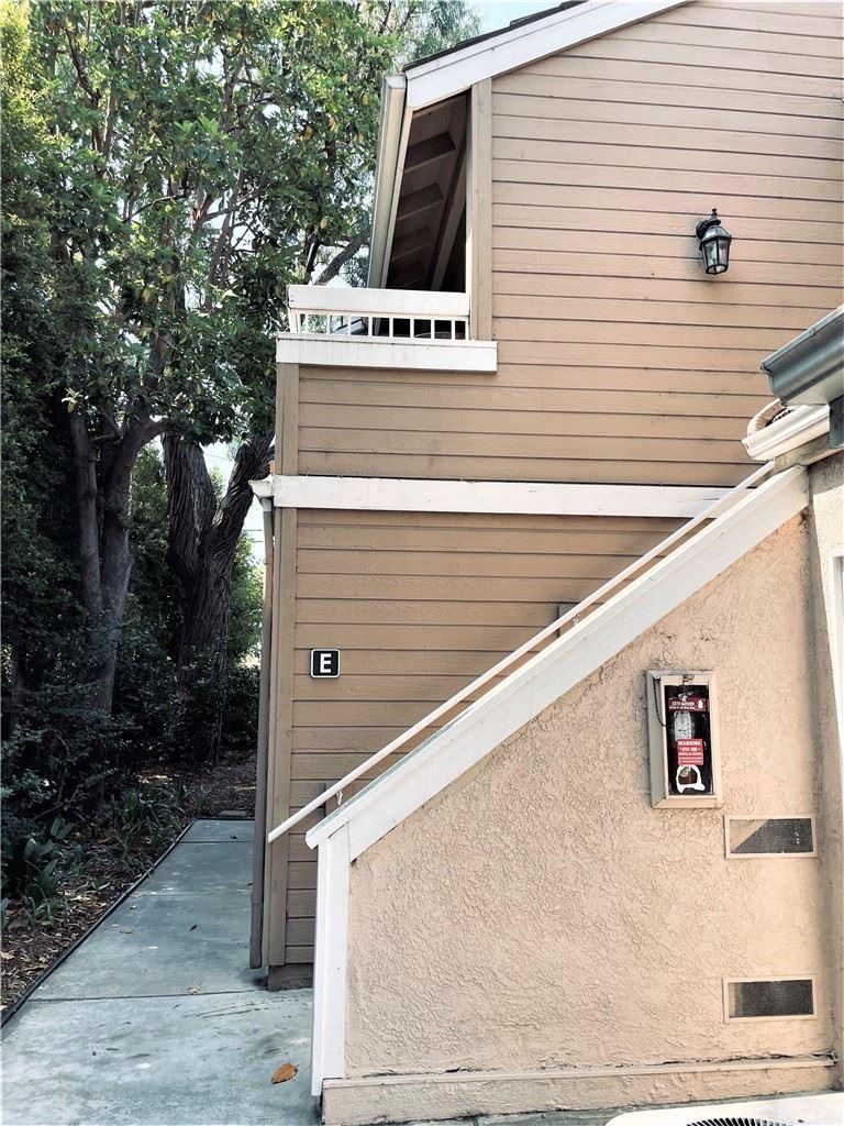 Photo of 10480 E Briar Oaks Drive #E, Stanton, CA 90680 (MLS # OC21152219)