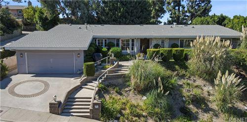 Photo of 3455 Caribeth Drive, Encino, CA 91436 (MLS # SR21203221)