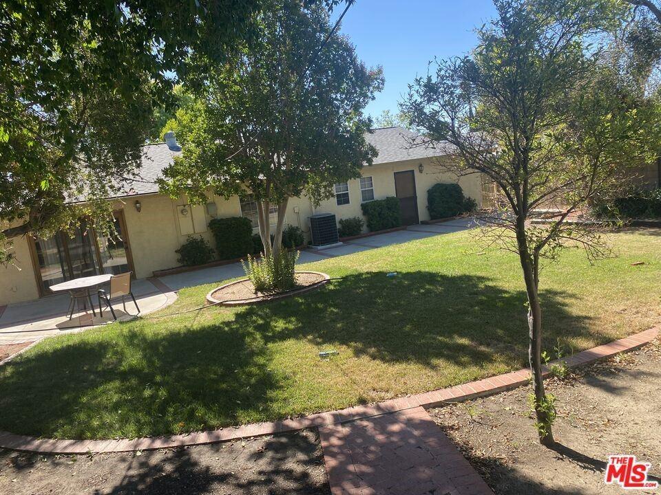 Photo of 11621 Paso Robles Avenue, Granada Hills, CA 91344 (MLS # 21792222)