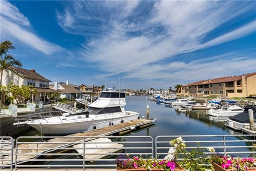 Photo of 17036 Bluewater Lane, Huntington Beach, CA 92649 (MLS # OC21102226)