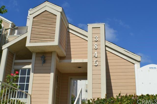 Photo of 3845 Farquhar Avenue #206, Los Alamitos, CA 90720 (MLS # PW21079226)