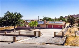 Photo of 8151 Palomar Avenue, Yucca Valley, CA 92284 (MLS # JT19192240)