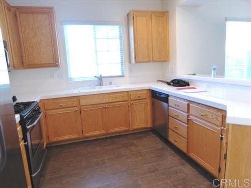Photo of 1464 Rancho Rose Way #26, Oceanside, CA 92057 (MLS # NDP2105247)
