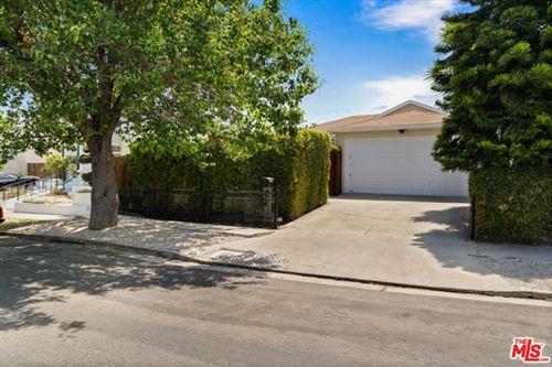 Photo of 1210 S Lucerne Boulevard, Los Angeles, CA 90019 (MLS # 21743250)