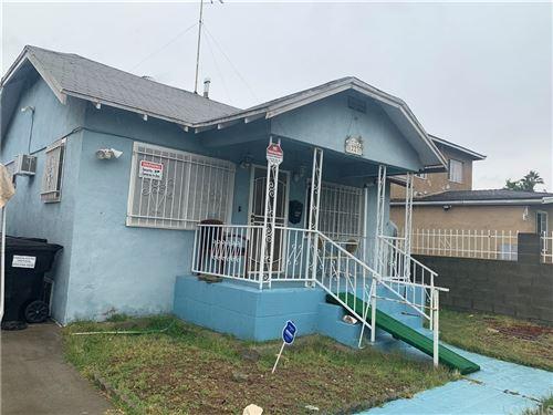 Photo of 1223 E 70th Street, Los Angeles, CA 90001 (MLS # IV21235250)