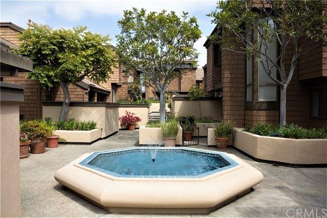 Photo of 31 Canyon Island Drive #31, Newport Beach, CA 92660 (MLS # OC21098255)