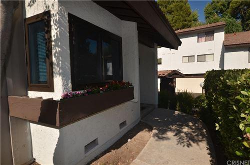 Photo of 21515 Erwin Street #12, Woodland Hills, CA 91367 (MLS # SR21161258)