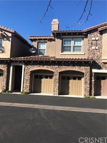 Photo of 21947 Bella Vista Place, Chatsworth, CA 91311 (MLS # SR21065263)