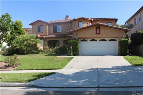 Photo of 1696 Tamarron Drive, Corona, CA 92883 (MLS # IG21206272)