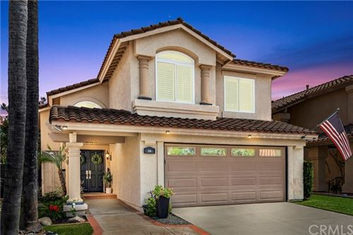 Photo of 58 Tavella Place, Lake Forest, CA 92610 (MLS # OC20193291)