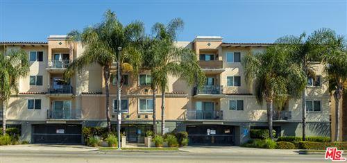 Photo of 13941 SHERMAN Way #403, Van Nuys, CA 91405 (MLS # 19517294)