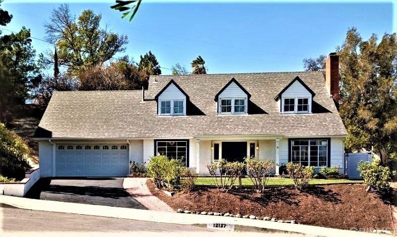 Photo of 12137 Bambi Place, Granada Hills, CA 91344 (MLS # SR21230296)