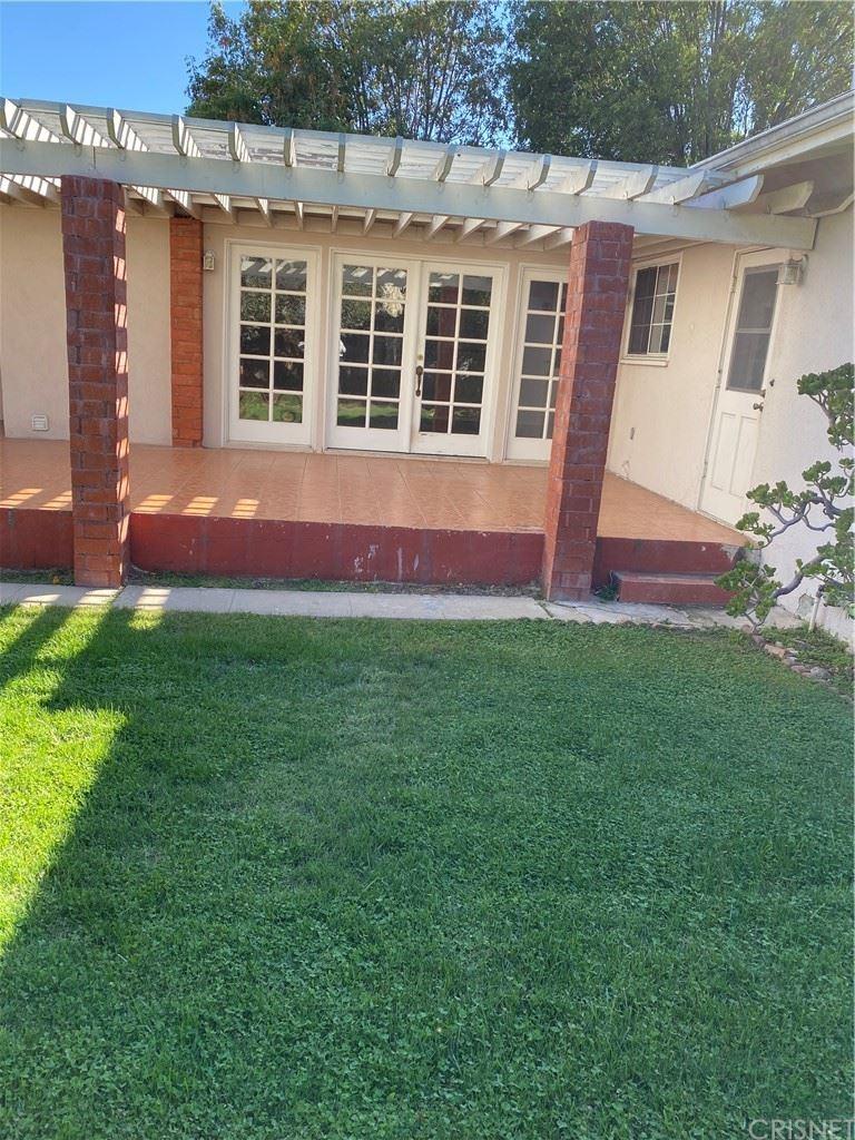 Photo of 16647 Tribune Street, Granada Hills, CA 91344 (MLS # SR21218307)