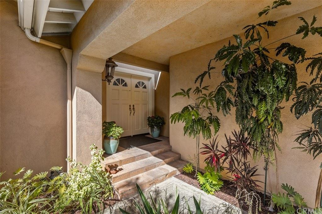 Photo of 27091 Ironwood Drive, Laguna Hills, CA 92653 (MLS # OC21209323)