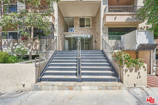 Photo of 970 S St Andrews Place #203, Los Angeles, CA 90019 (MLS # 20658326)