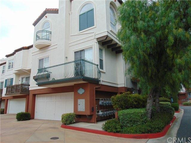 Photo of 12643 TRENT JONES Lane, Tustin, CA 92782 (MLS # OC21091341)