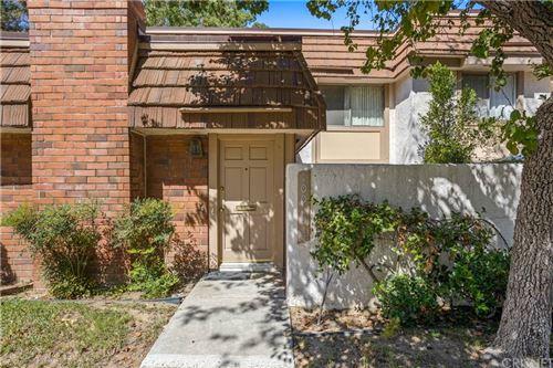 Photo of 10060 Larwin Avenue #5, Chatsworth, CA 91311 (MLS # SR21207344)
