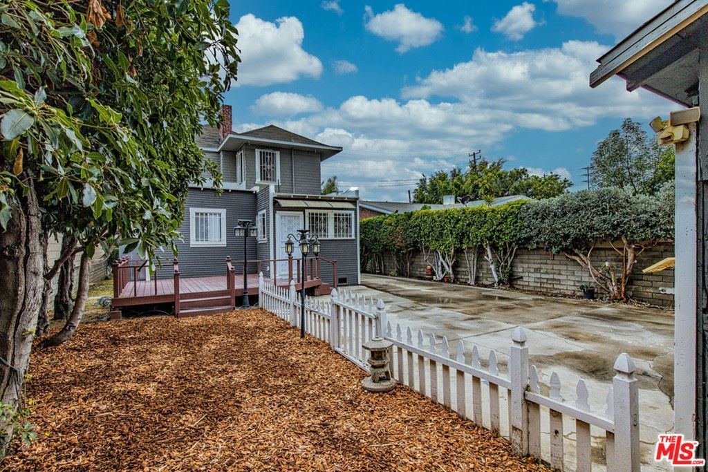 Photo of 1661 W 35Th Place, Los Angeles, CA 90018 (MLS # 21733346)