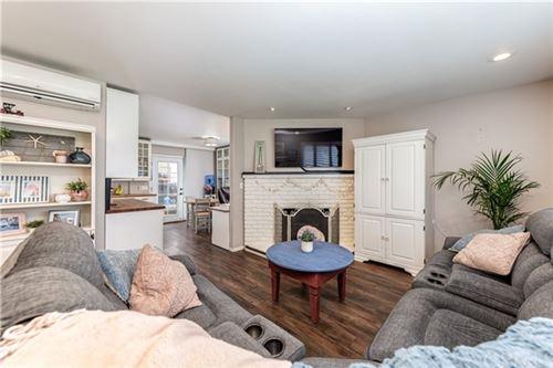 Photo of 9619 Kensington Drive, Huntington Beach, CA 92646 (MLS # OC21101348)
