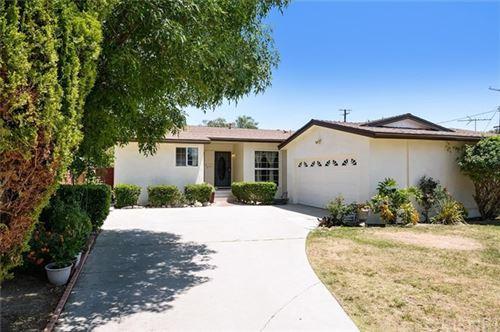 Photo of 9148 Valjean Avenue, North Hills, CA 91343 (MLS # SR21102358)