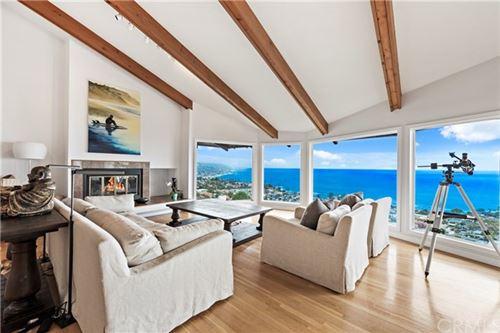 Photo of 549 DUNNEGAN Drive, Laguna Beach, CA 92651 (MLS # LG21028361)