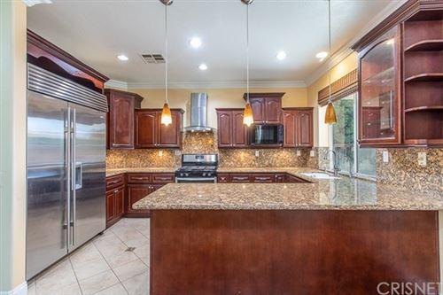 Photo of 8231 Chamberlain Lane, Reseda, CA 91335 (MLS # SR20138362)