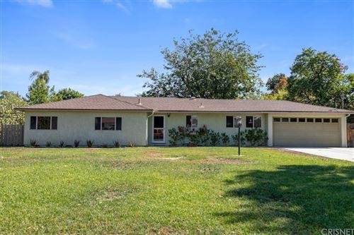 Photo of 8542 De Celis Place, North Hills, CA 91343 (MLS # SR21223363)