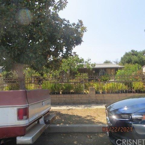 Photo of 8401 Cantaloupe Avenue, Panorama City, CA 91402 (MLS # SR21189367)
