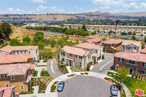 Photo of 26956 TRESTLES Drive, Santa Clarita, CA 91351 (MLS # 20594386)