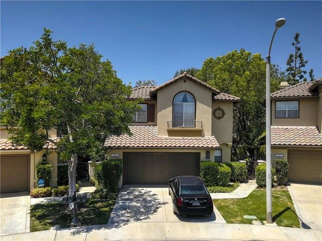 Photo of 12151 Mcculla Drive, Tustin, CA 92782 (MLS # NP21098388)