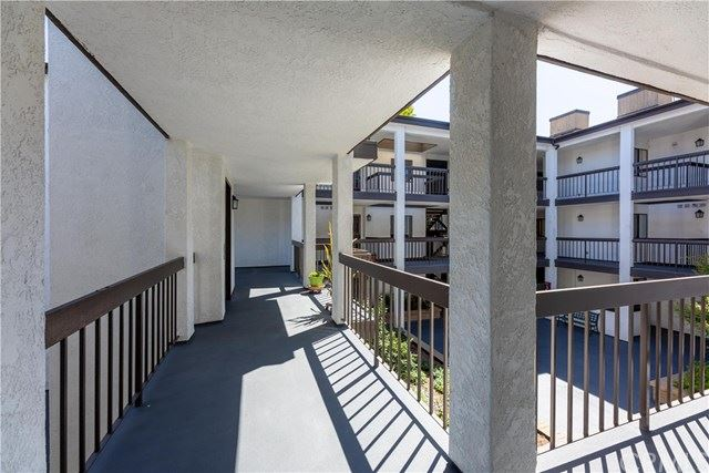Photo of 2514 E Willow Street #201, Signal Hill, CA 90755 (MLS # PW20162388)