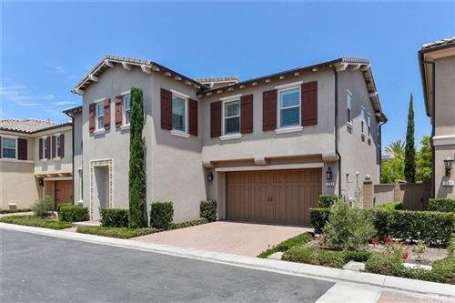 Photo of 203 Desert Bloom, Irvine, CA 92618 (MLS # OC21120389)
