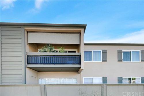 Photo of 25735 Hogan Drive #E4, Valencia, CA 91355 (MLS # SR20198393)