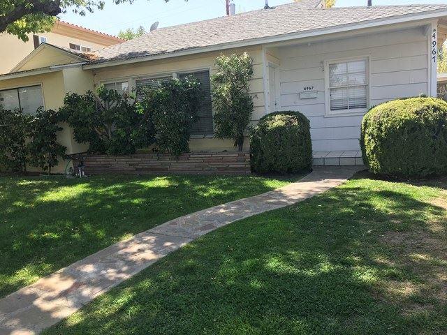 Photo of 4967 Garden Grove Avenue, Tarzana, CA 91356 (MLS # 219059863DA)