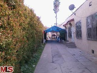 Photo of 1424 MEADOWBROOK Avenue, Los Angeles, CA 90019 (MLS # 12595401)
