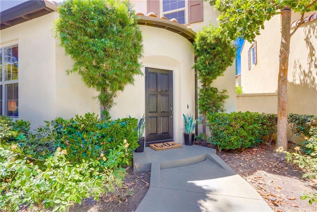 Photo of 99 Sarabande, Irvine, CA 92620 (MLS # OC21166402)