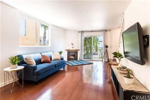 Photo of 1434 S Point View Street #101, Los Angeles, CA 90035 (MLS # CV20149405)