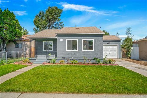 Photo of 1411 W Magnolia Street, Compton, CA 90220 (MLS # MB21229409)