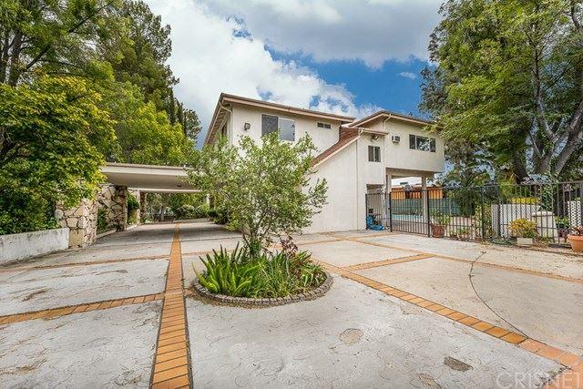 Photo of 15813 High Knoll Road, Encino, CA 91436 (MLS # SR20107429)