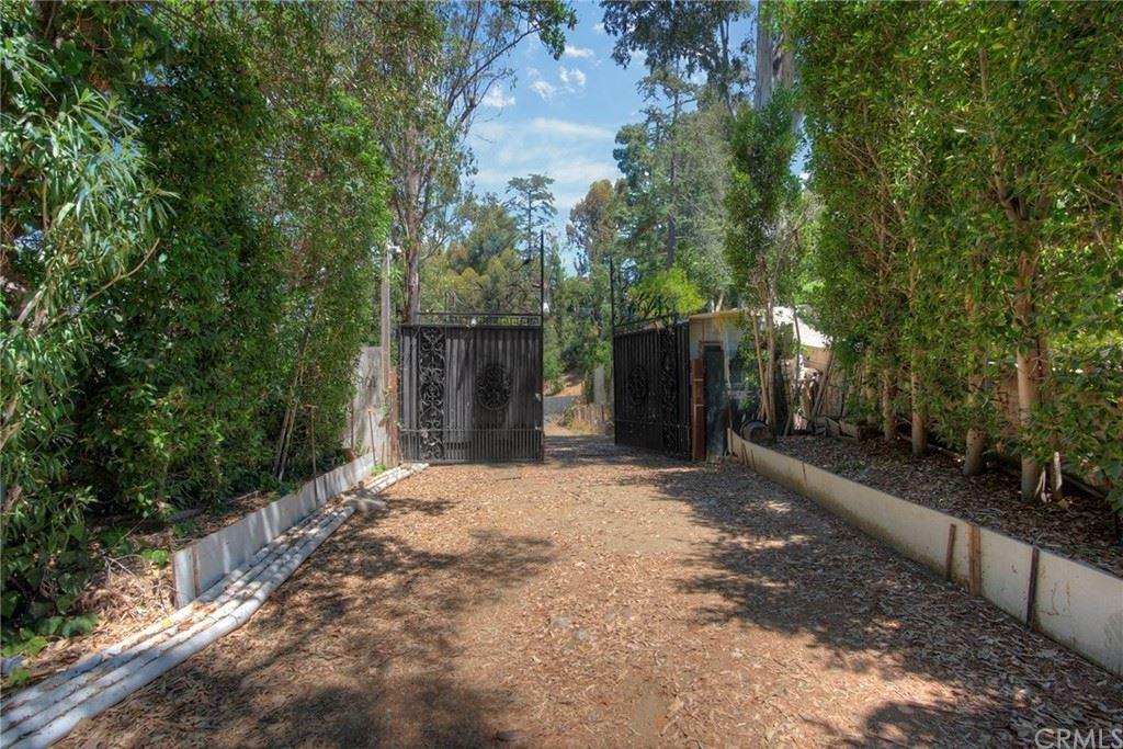 Photo of 901 Strada Vecchia Road, Bel Air, CA 90077 (MLS # SB21180443)