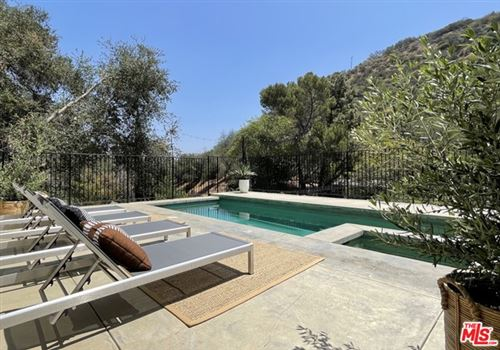 Photo of 8569 Lookout Mountain Avenue, Los Angeles, CA 90046 (MLS # 21732444)