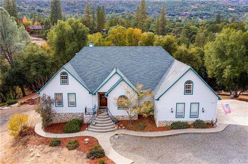 Photo of 49782 Meadowview Drive, Oakhurst, CA 93644 (MLS # FR21233454)