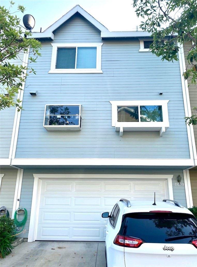 Photo of 13053 Springarden Lane, Westminster, CA 92683 (MLS # PW21158455)