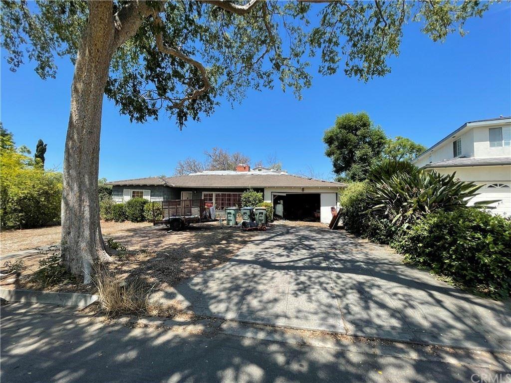 Photo of 705 Rim Road, Pasadena, CA 91107 (MLS # CV21209479)