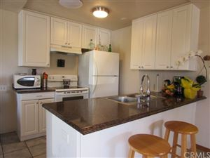 Photo of 22011 Rimhurst Drive #179, Lake Forest, CA 92630 (MLS # PW19256483)