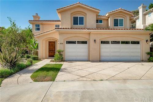 Photo of 9639 Paso Robles Avenue, Northridge, CA 91325 (MLS # CV20077486)