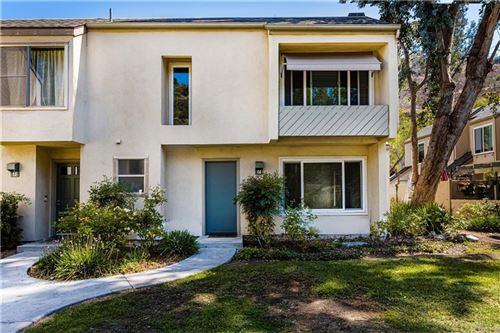 Photo of 307 N Singingwood Street #14, Orange, CA 92869 (MLS # PW21212489)